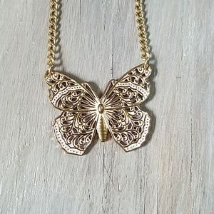 Jewelry - Pink and gold toned butterfly necklace